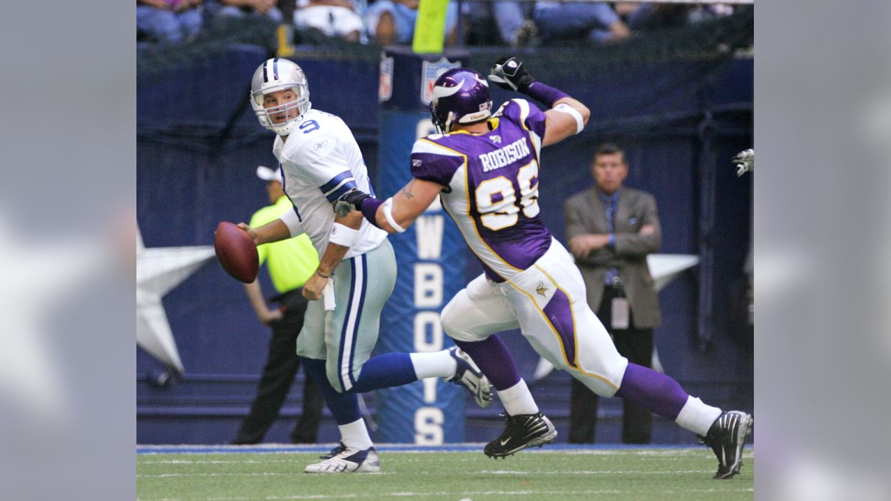 Dallas Cowboys quarterback Tony Romo (9) scrambles as Minnesota Vikings defensive end Brian Robison (96) tackles during an NFL football game, Sunday, Oct. 21, 2007, in Irving, Texas. (AP Photo/LM Otero)