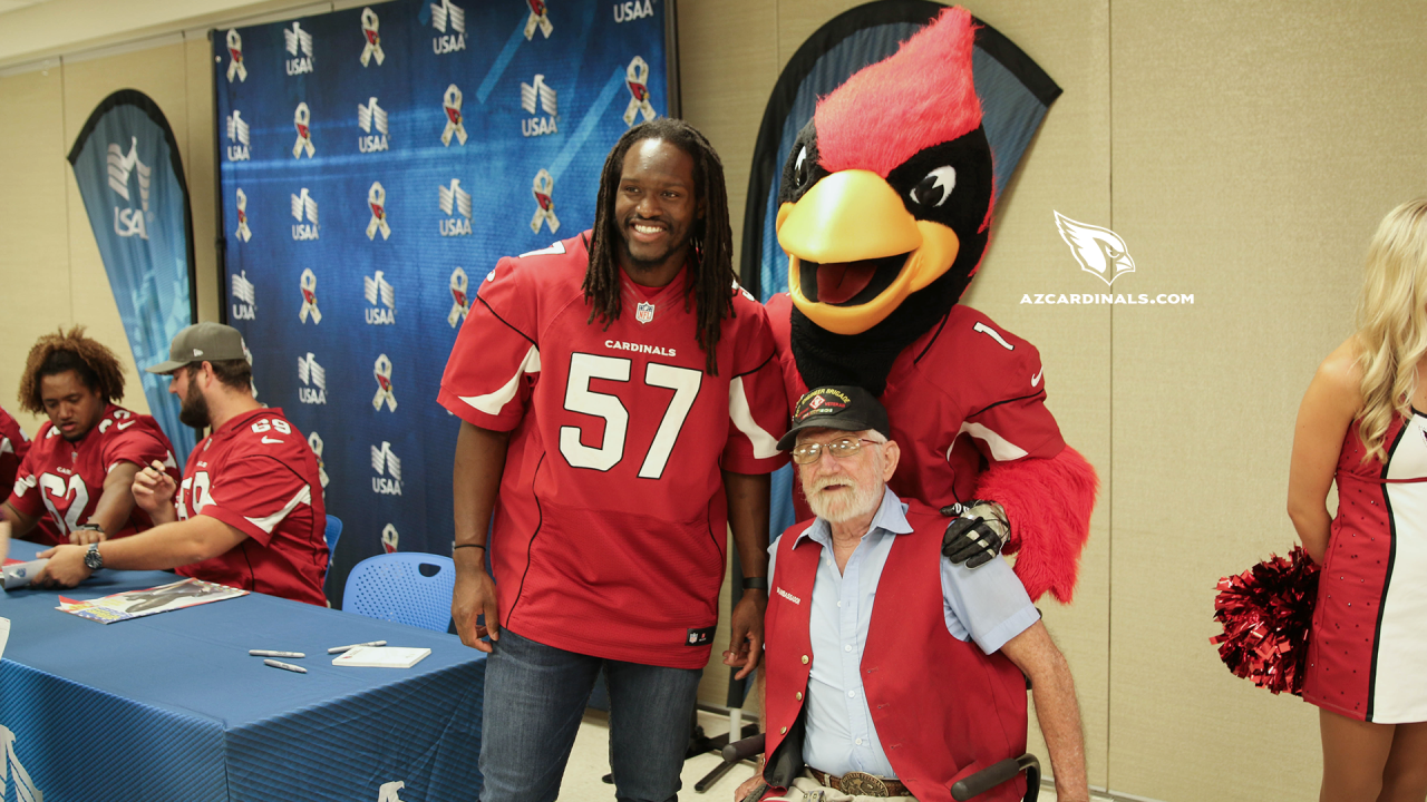 LB Josh Bynes and Big Red pose with a vet