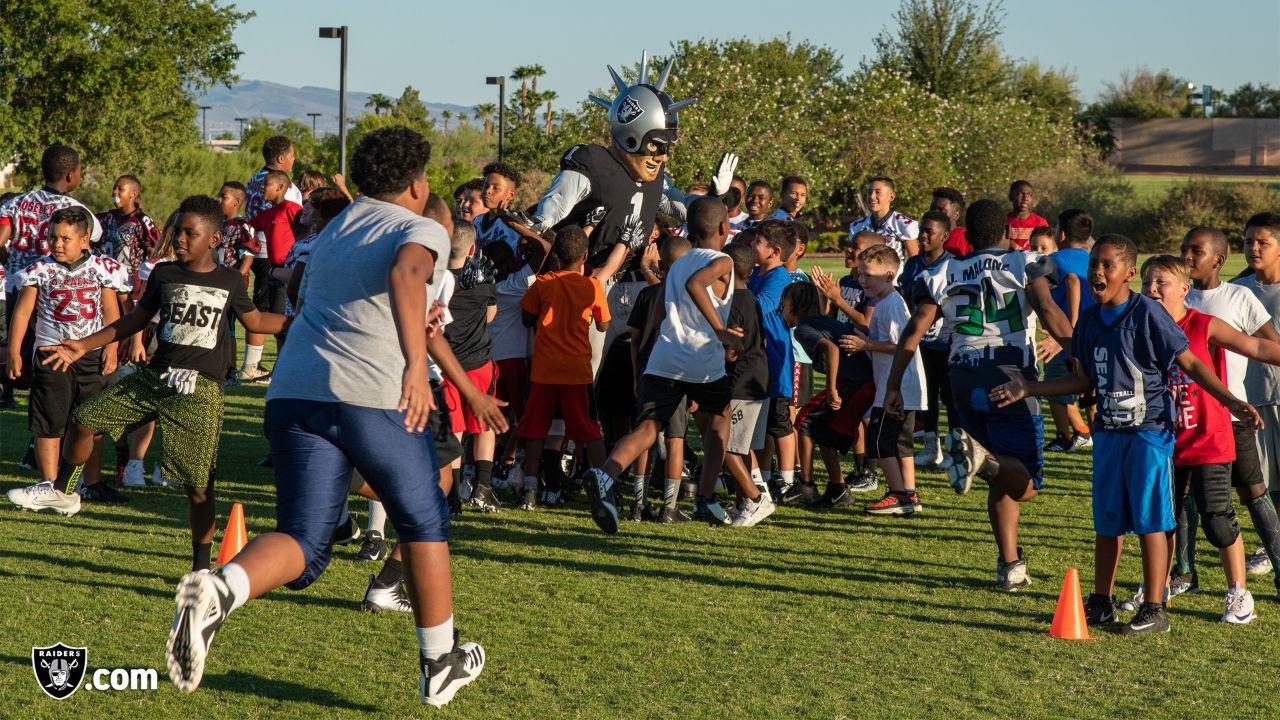 Raiders donate helmets to Las Vegas youth