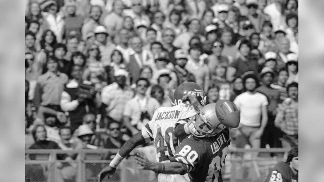 a91901c5 Seattle Seahawks receiver Steve Largent (80) takes a last glance at the  pigskin after