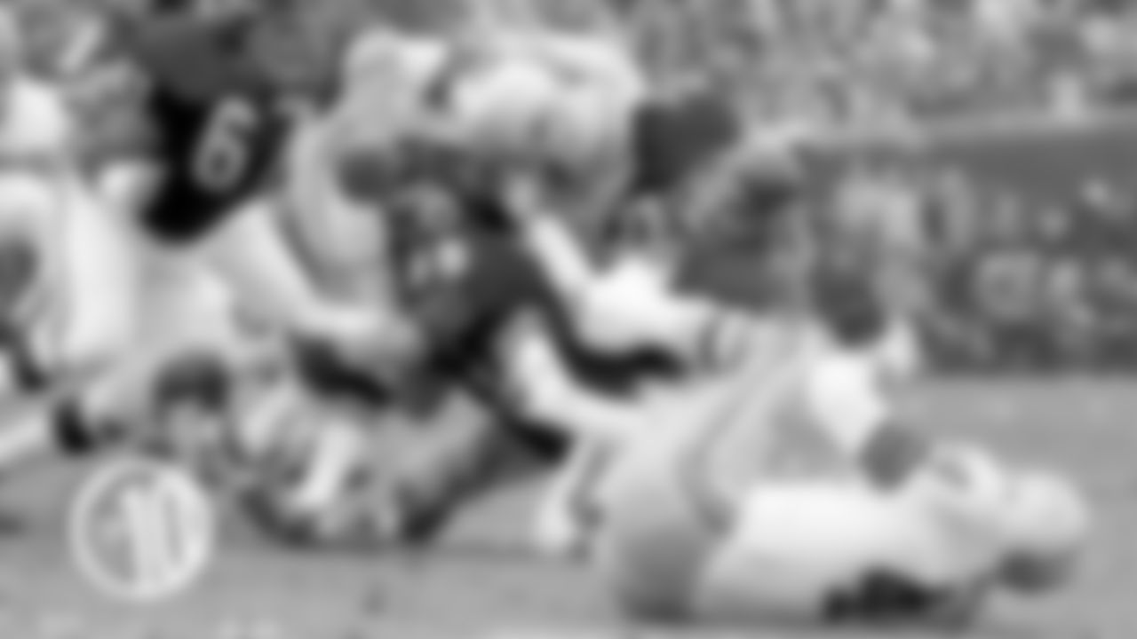 10. Bears linebackers Doug Buffone (55) and Dick Butkus (51) teamed up to force a Packers fumble in a 1967 game at Wrigley Field.