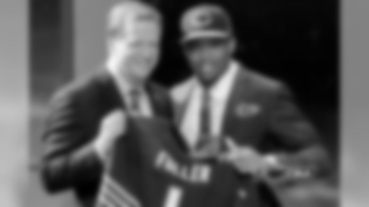 Virginia Tech cornerback Kyle Fuller poses with NFL commissioner Roger Goodell after being selected by the Chicago Bears as the 14th pick in the first round of the 2014 NFL Draft.