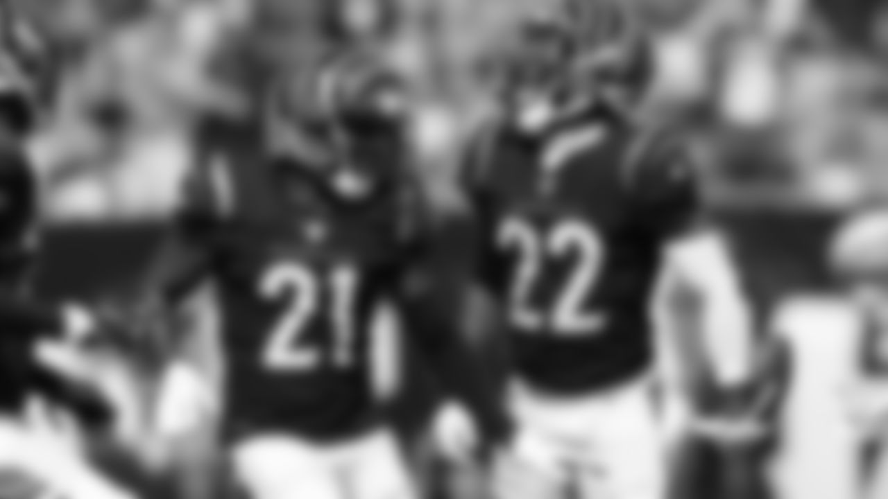 Cincinnati Bengals cornerback Chidobe Awuzie (22) celebrates an interception with Mike Hilton (21) in the first half of an NFL football game against the Green Bay Packers in Cincinnati, Sunday, Oct. 10, 2021. (AP Photo/AJ Mast)