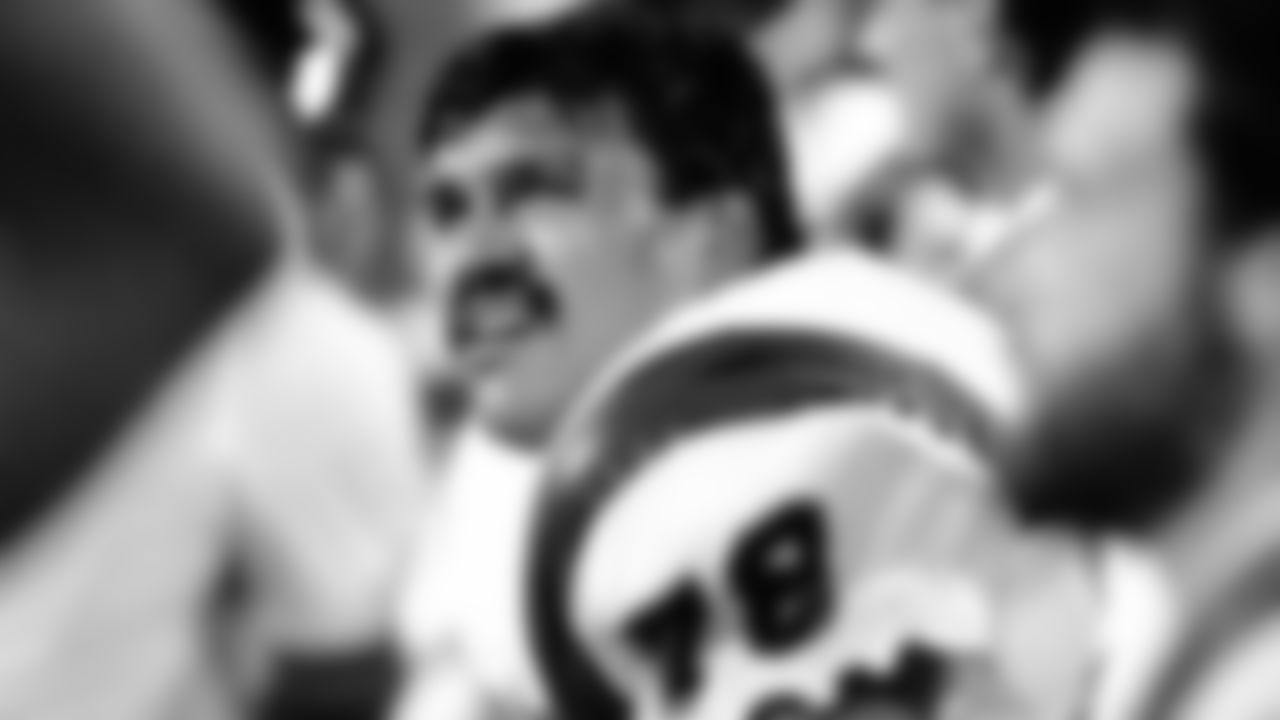 Cincinnati Bengals Hall of Fame tackle Anthony Munoz (78) watches from the sideline during the NFL Super Bowl XXIII game against the San Francisco 49ers on January 22, 1989, in Miami, Fla.