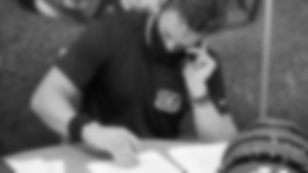 Quarterback Joe Burrow looking over his contract at Paul Brown Stadium.