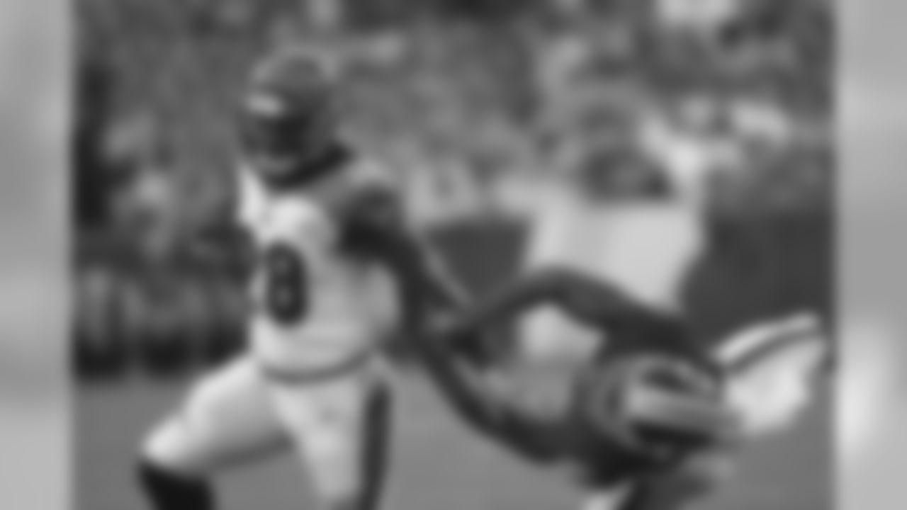 Cincinnati Bengals running back Joe Mixon (28) runs past Washington Redskins cornerback Josh Norman, right, during the first quarter of an NFL preseason football game in Landover, Md., Thursday, Aug. 15, 2019. (AP Photo/Susan Walsh)