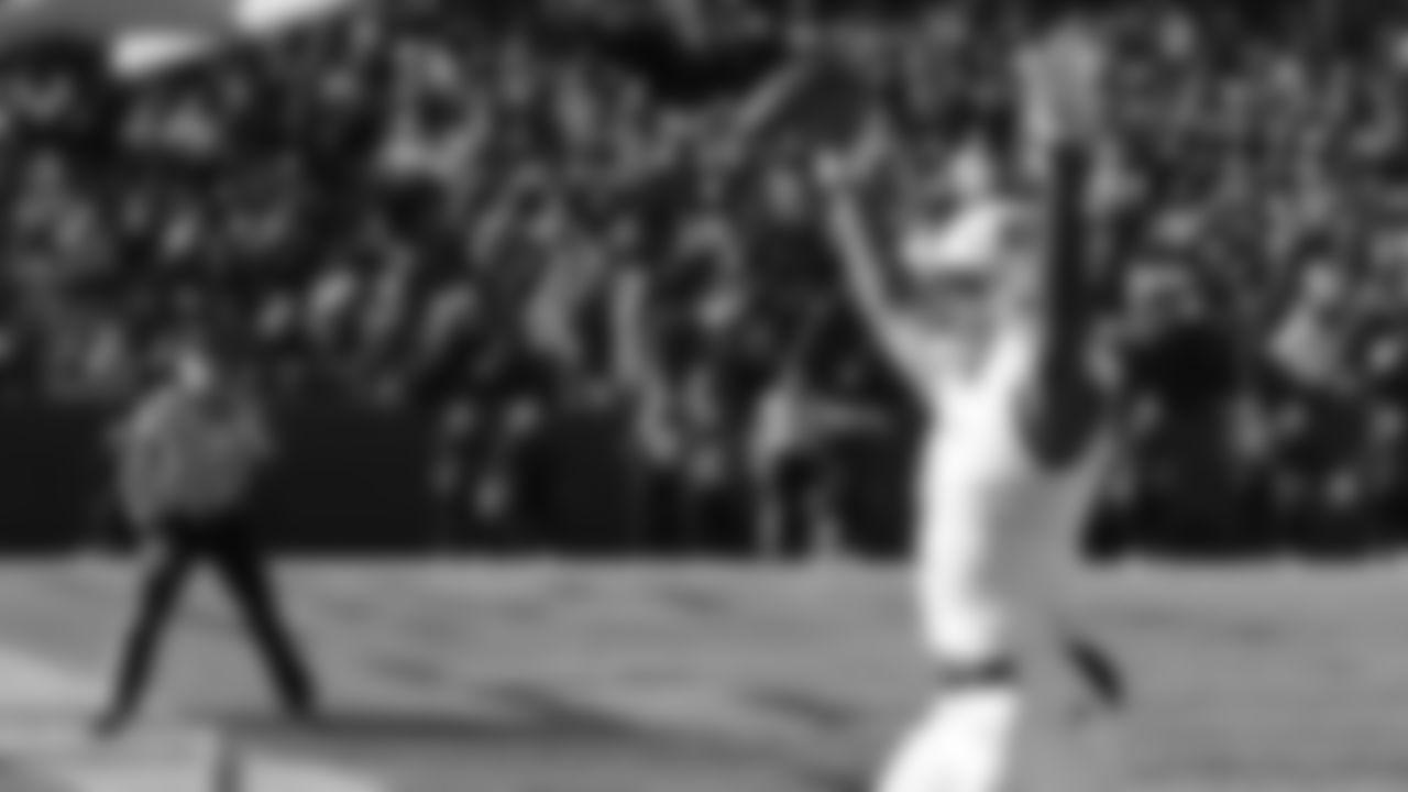 Kansas running back Pooka Williams celebrates a touchdown during the second half of an NCAA college football game against Iowa State, Saturday, Nov. 23, 2019, in Ames, Iowa. Iowa State won 41-31. (AP Photo/Matthew Putney)