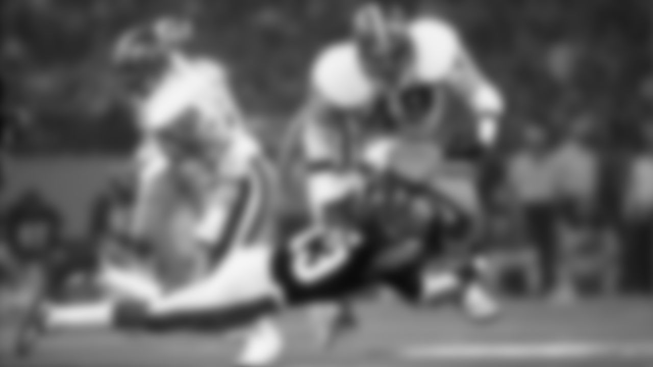 Ken Riley of the Cincinnati Bengals dives to bring down San Francisco 49ers fullback Earl Cooper (49) at the Pontiac Silverdome in Super Bowl XVI on January 24, 1982. San Francisco won 26-21.  (AP Photo / Al Messerschmidt)