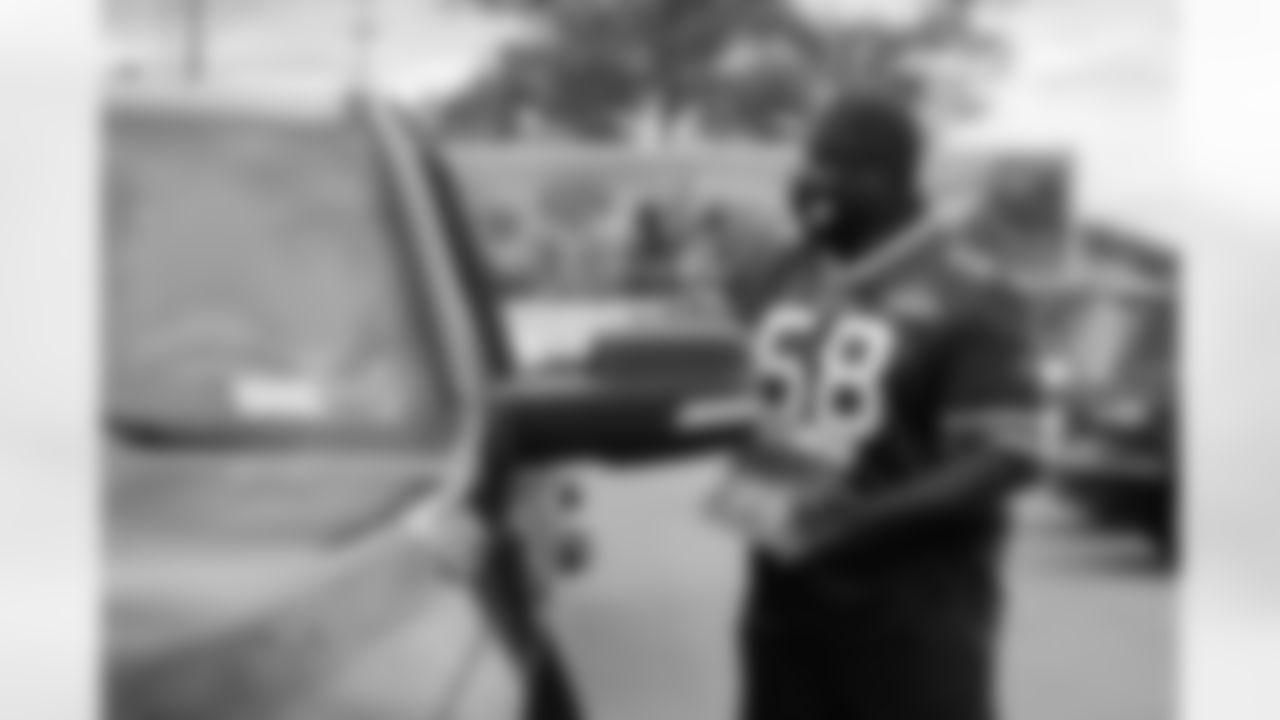 Buffalo Bills Huddle for Hunger food drive at Highmark Stadium, September 23, 2021.  Photo by Ben Green