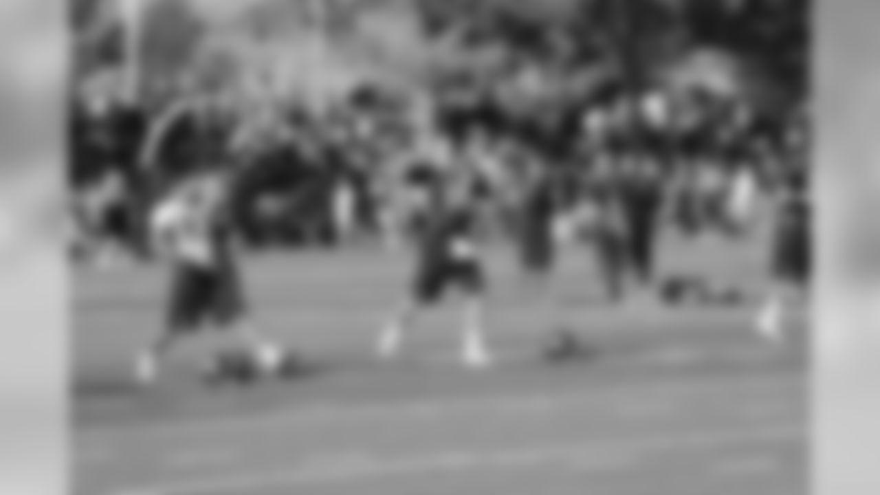 QB Peyton Manning throws a pass during warm-ups.