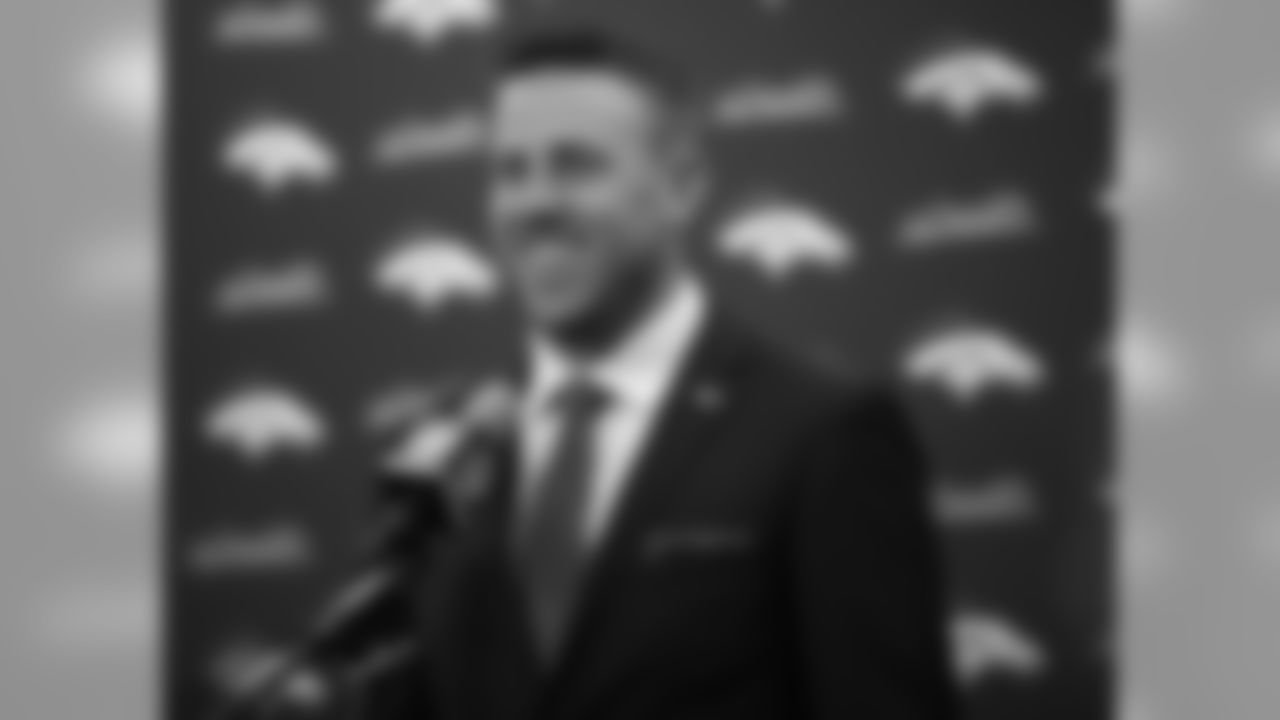 Case Keenum smiles during a news conference to introduce him as the new starting quarterback of the Denver Broncos NFL football team, at the team's headquarters Friday, March 16, 2018, in Englewood, Colo. (AP Photo/David Zalubowski)