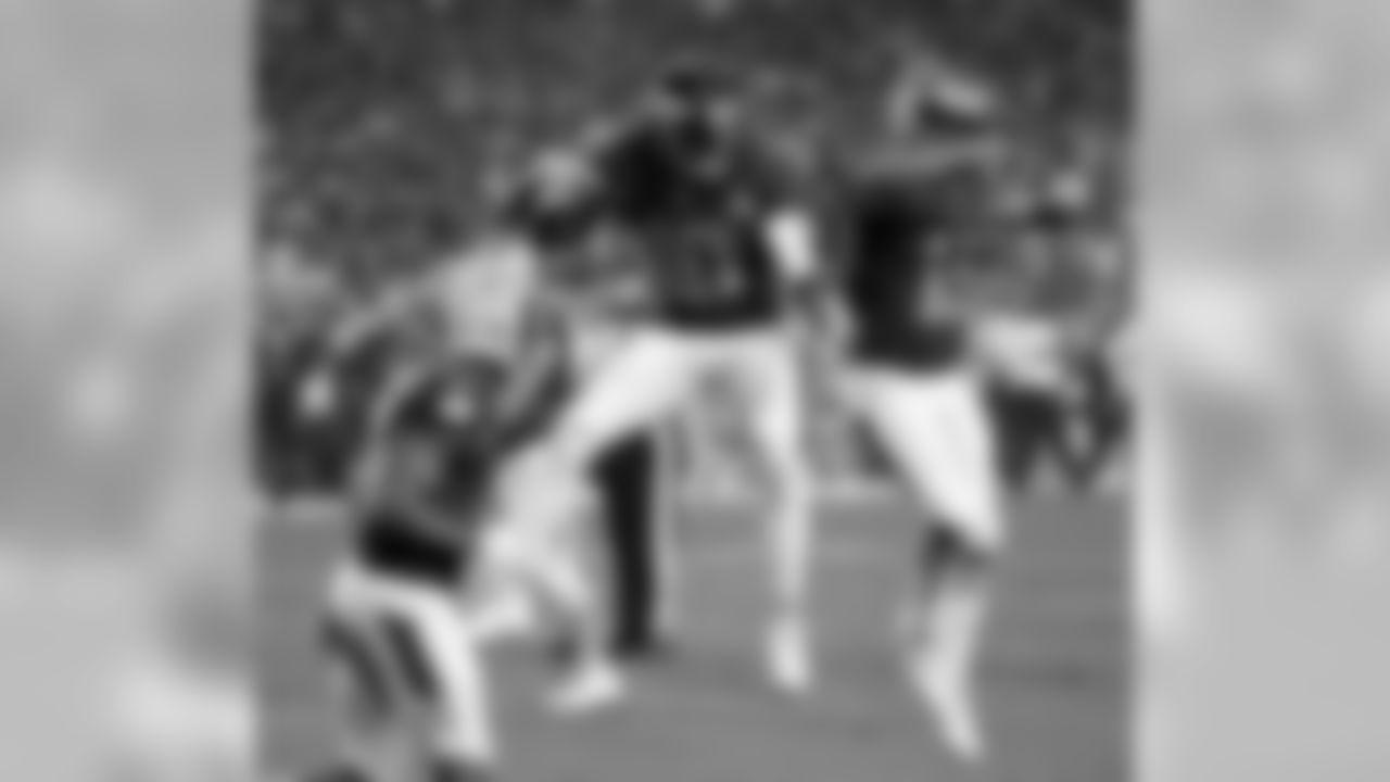 Denver Broncos wide receiver Emmanuel Sanders (10) celebrates with Detroit Lions wide receiver Golden Tate after scoring a touchdown in the Pro Bowl.