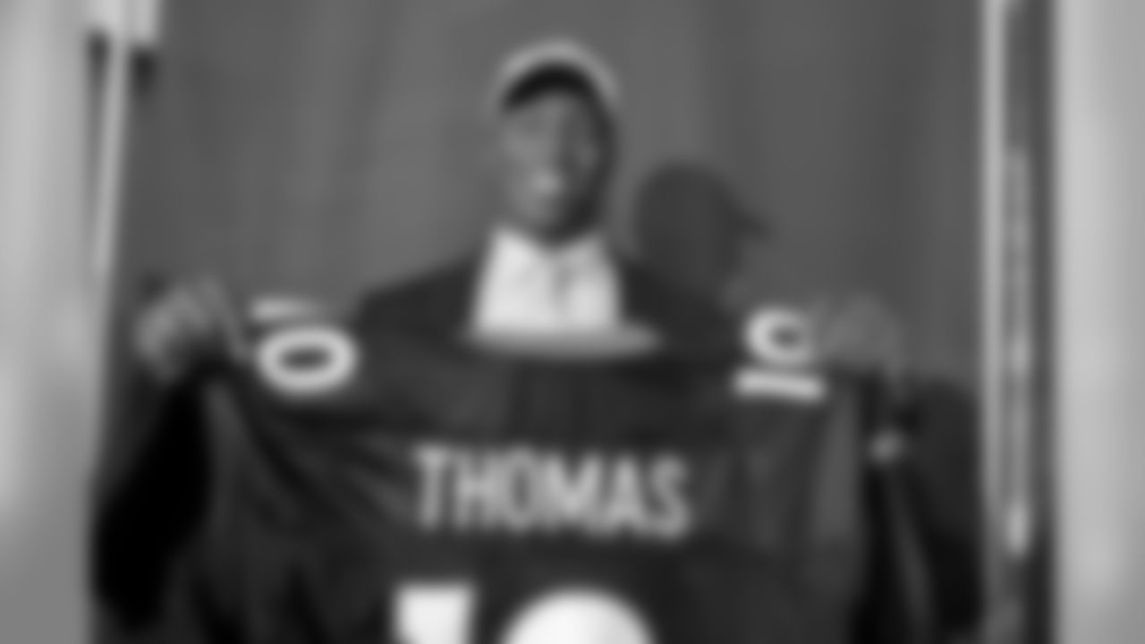 Drafted in the first round at 22nd overall of the 2010 NFL Draft, Demaryius Thomas holds up his jersey.