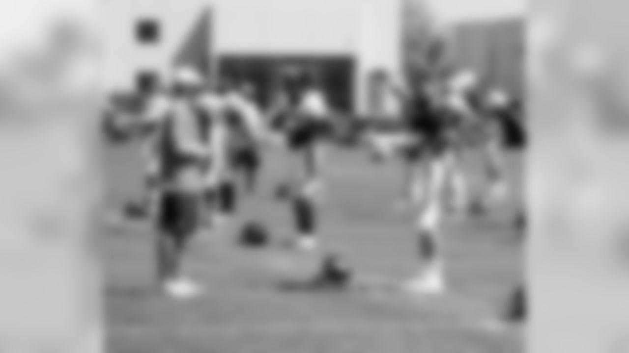 Offensive Coordinator Adam Gase and QB Peyton Manning
