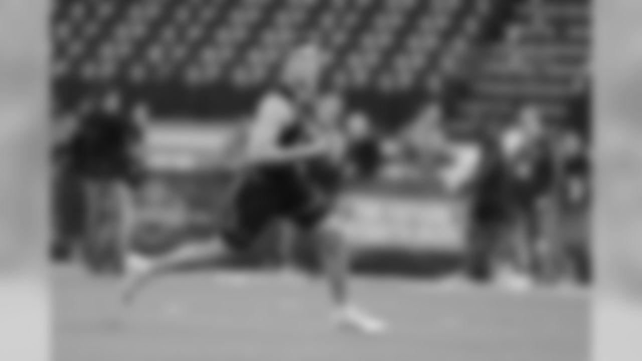 Missouri quarterback Drew Lock runs a drill during the NFL football scouting combine, Saturday, March 2, 2019, in Indianapolis. (AP Photo/Darron Cummings)