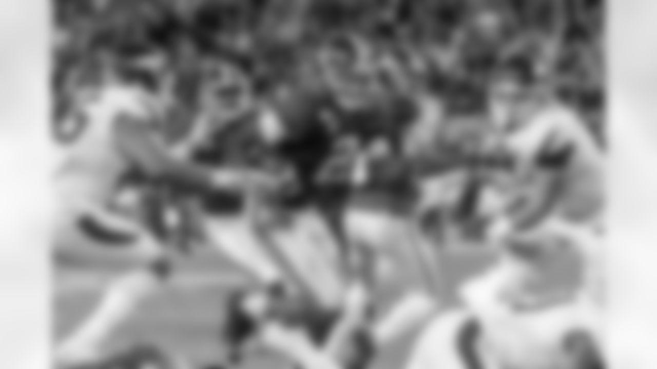 Alabama defensive back Patrick Surtain II (2) returns an interception against Arkansas during the first half of an NCAA college football game, Saturday, Oct. 26, 2019, in Tuscaloosa, Ala. (AP Photo/Vasha Hunt)