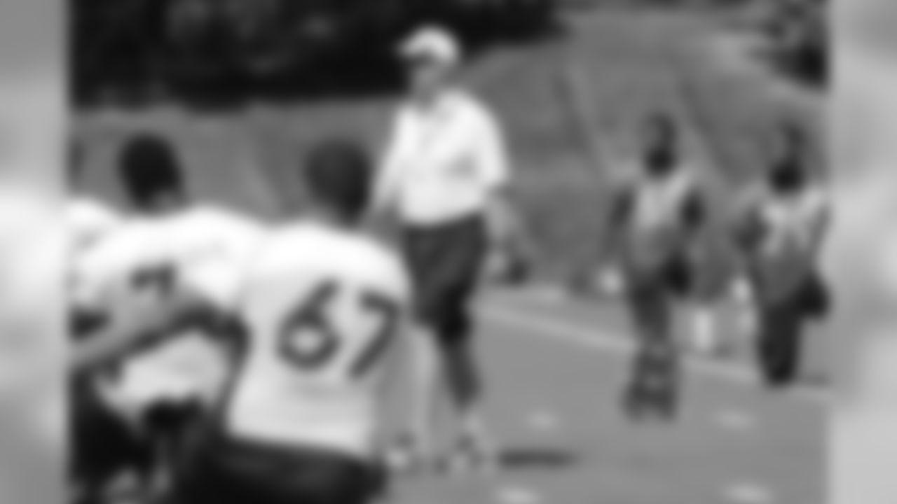 Head Coach John Fox walks through the stretching lines.