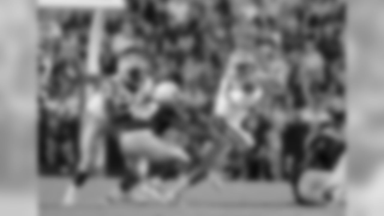 LSU quarterback Joe Burrow (9) scrambles as center Lloyd Cushenberry III (79) blocks Southeastern Louisiana linebacker Tamarcus Russell (42) in the second half of an NCAA college football game in Baton Rouge, La., Saturday, Sept. 8, 2018. LSU won 31-0. (AP Photo/Gerald Herbert)