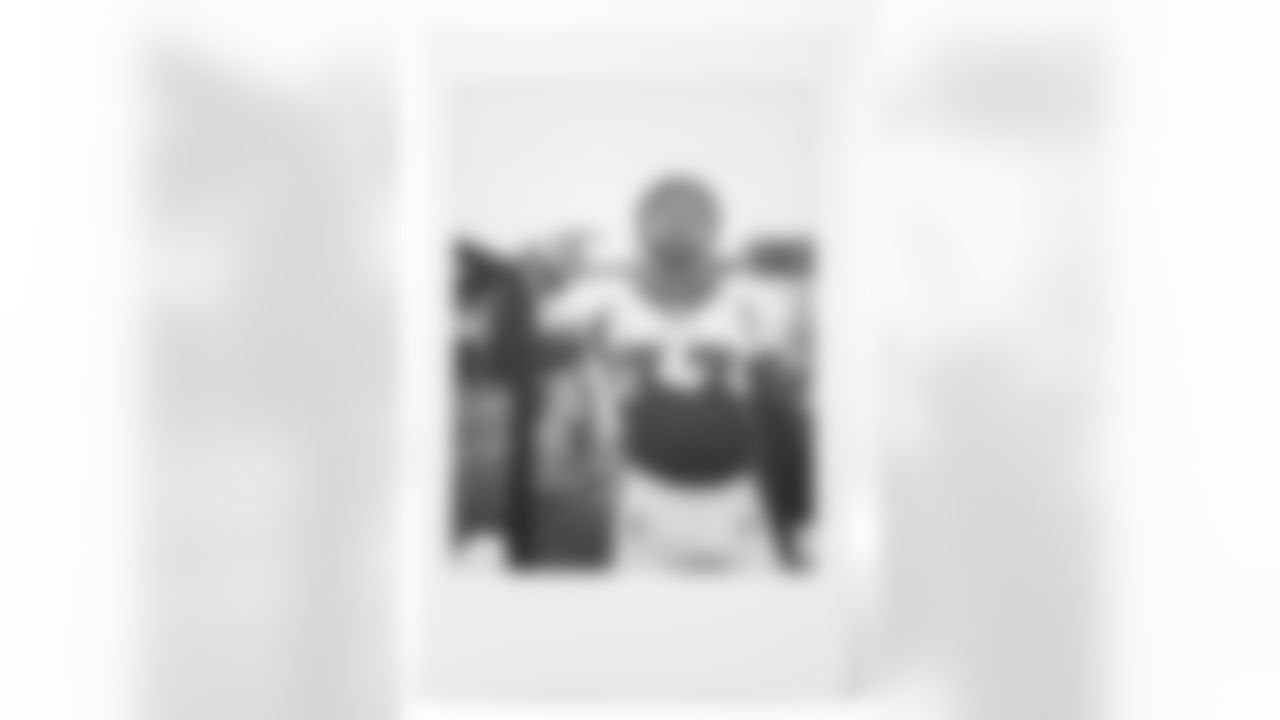 An instant film photo of Javonte Williams from 2021 Broncos training camp practices. (Photo by Ben Swanson)