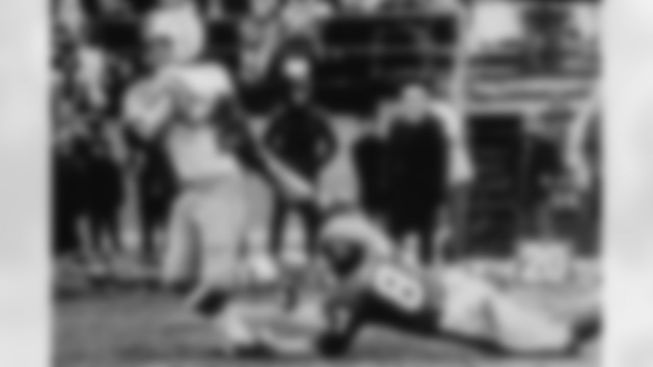 Rich Jackson pulls at a Chargers ballcarrier's jersey.