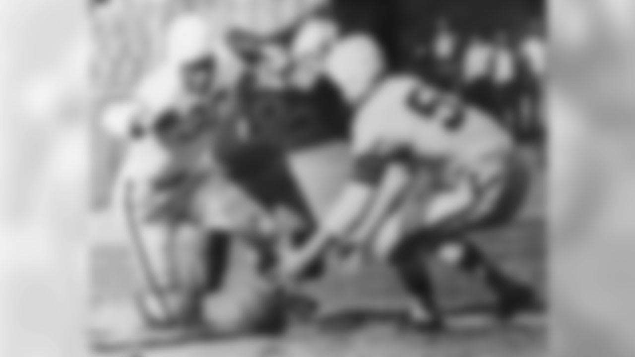 Alton Coppage and Bill Willis pounce on a fumble in 1946.