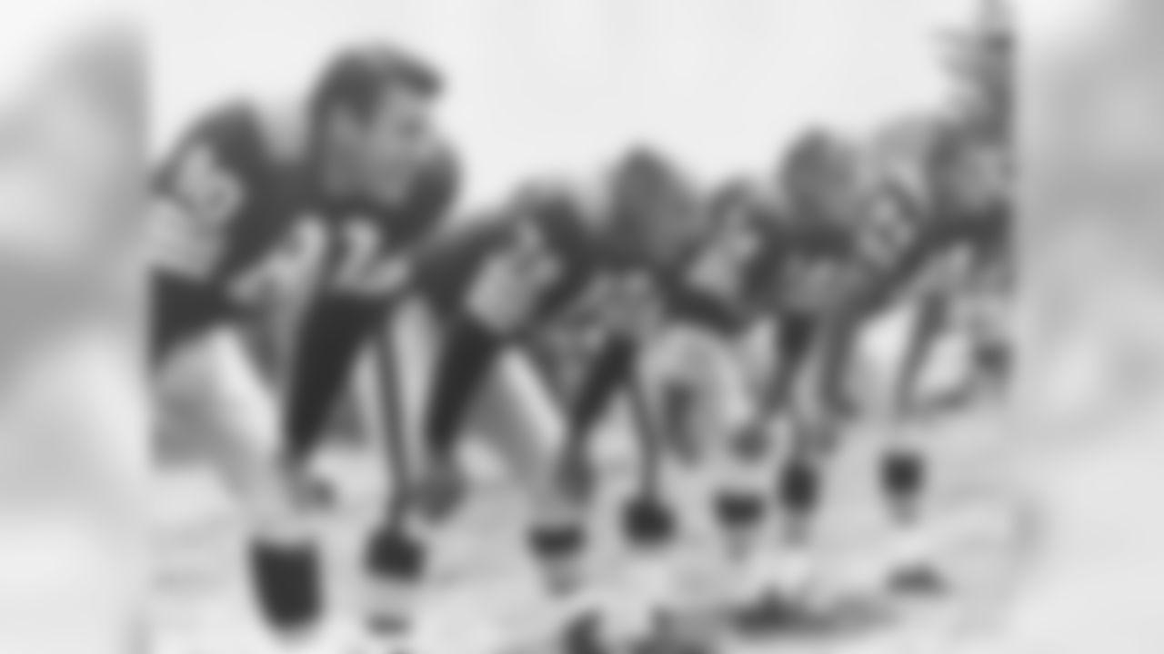 Bill Glass, Bob Gain, Dick Modzelewski and Paul Wiggin mug for a photo during training camp in 1964.