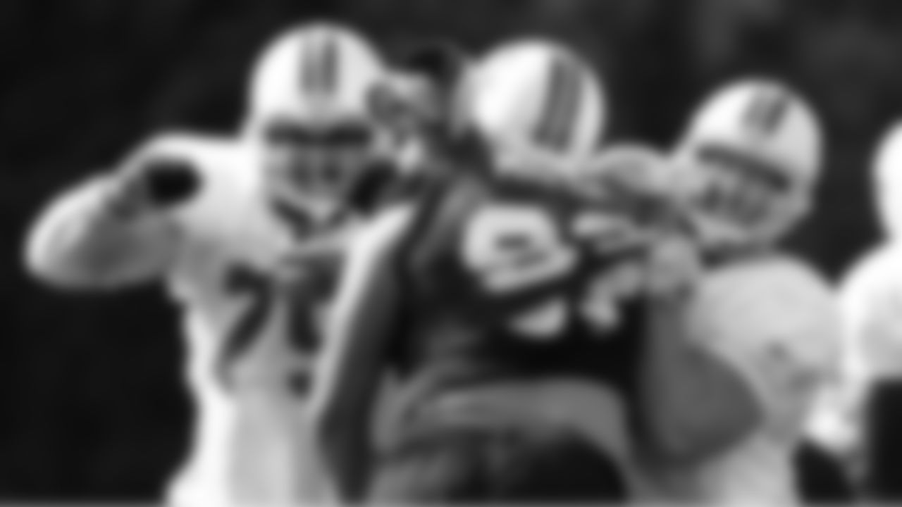 Rookie DT Roy Miller gets double-teamed as he tries to fight into the backfield