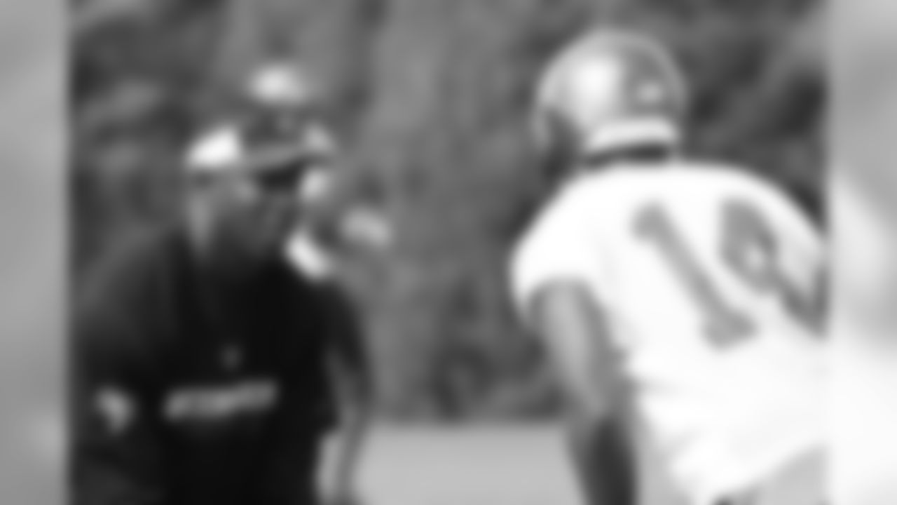 Head Coach Raheem Morris gives WR Pat Carter the look of press coverage before the snap