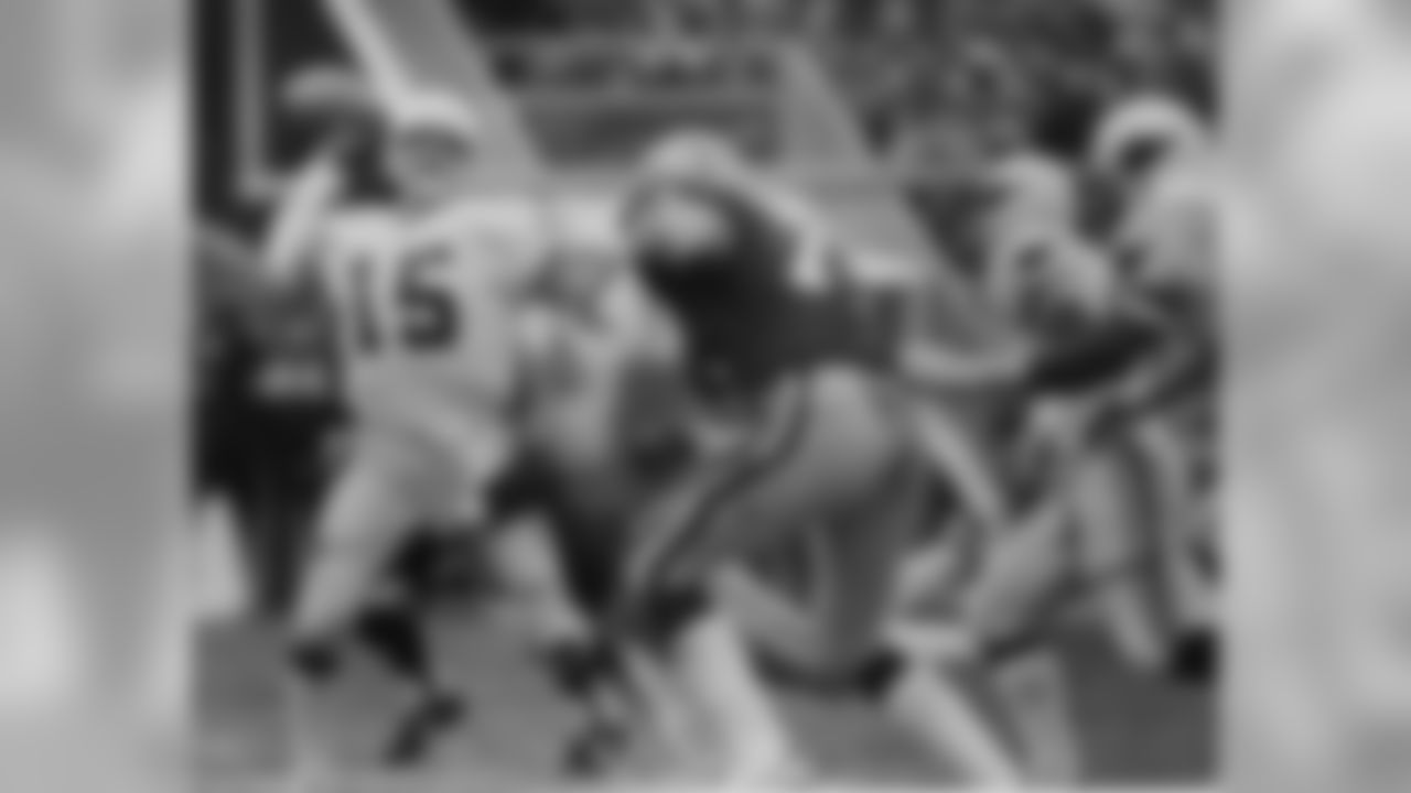 1982: Cardinals QB Neil Lomax throws a pass as Packers DE Mike Butler pressures