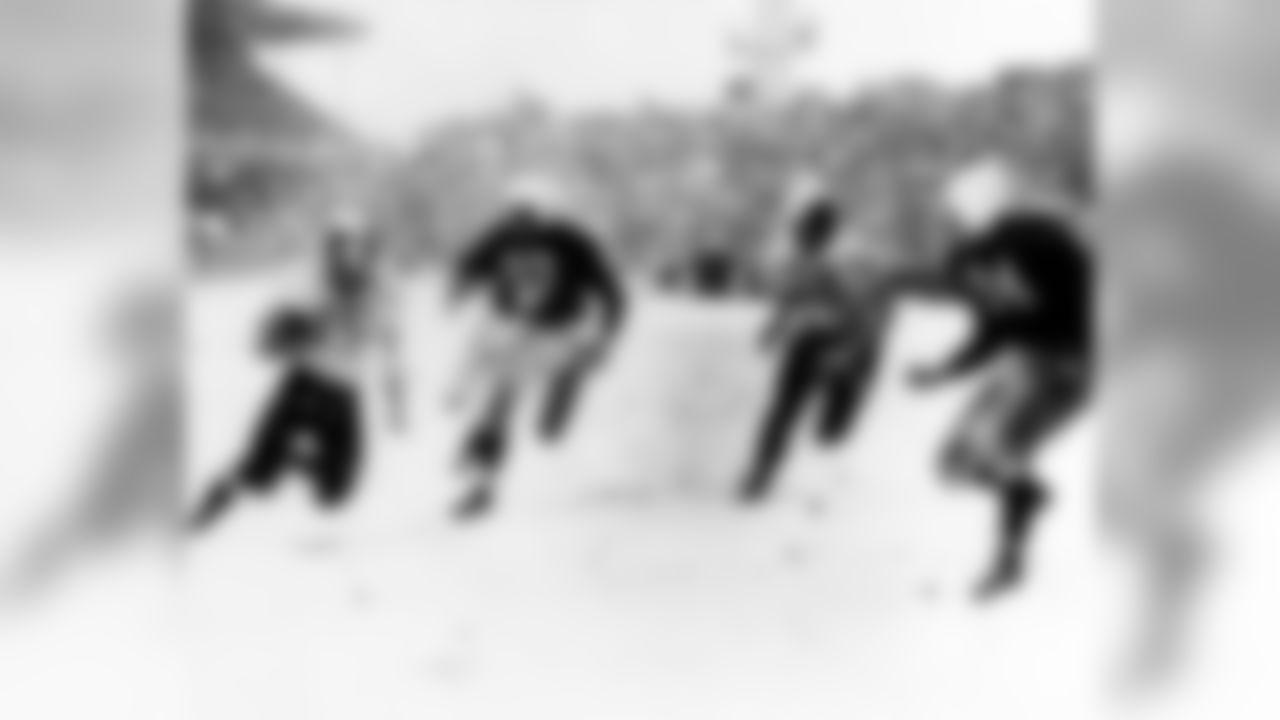 1948: Eagles RB Steven Van Buren runs with LB Corwin Clatt in pursuit