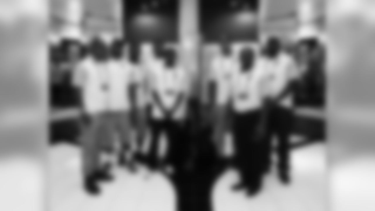 The Cardinals at the symposium (from left): RB David Johnson, TE Gerald Christian, LB Markus Golden, T D.J. Humphries, WR J.J. Nelson, LB Shaq Riddick, senior director of player development Anthony Edwards and DE Rodney Gunter