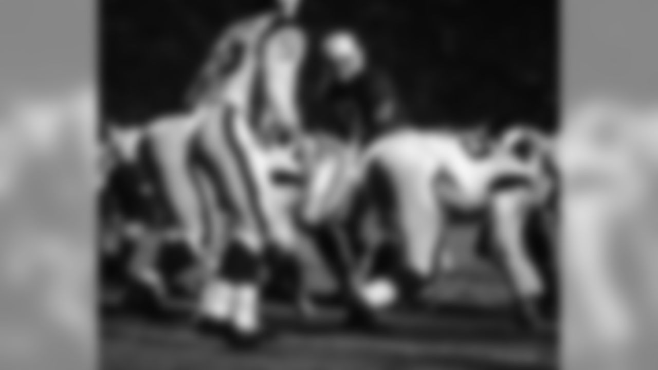 1966: Cardinals QB Charley Johnson at the line