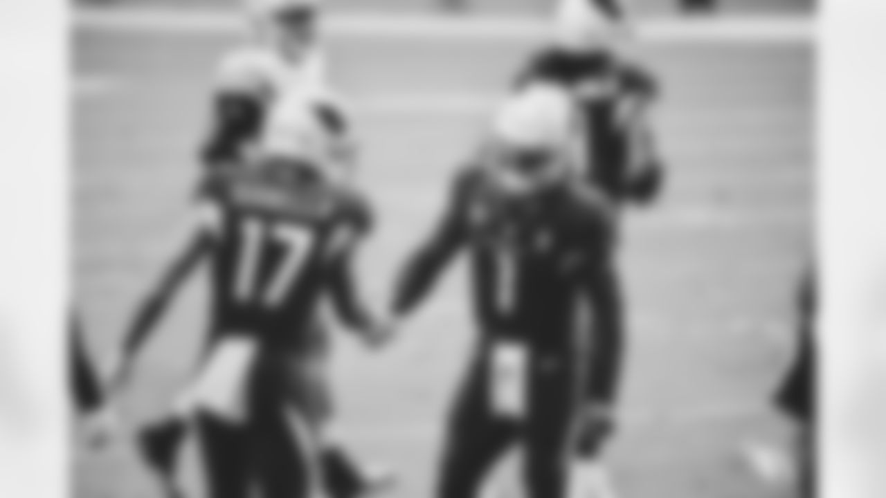 QB Kyler Murray congratulates WR Andy Isabella after they connected on a touchdown.