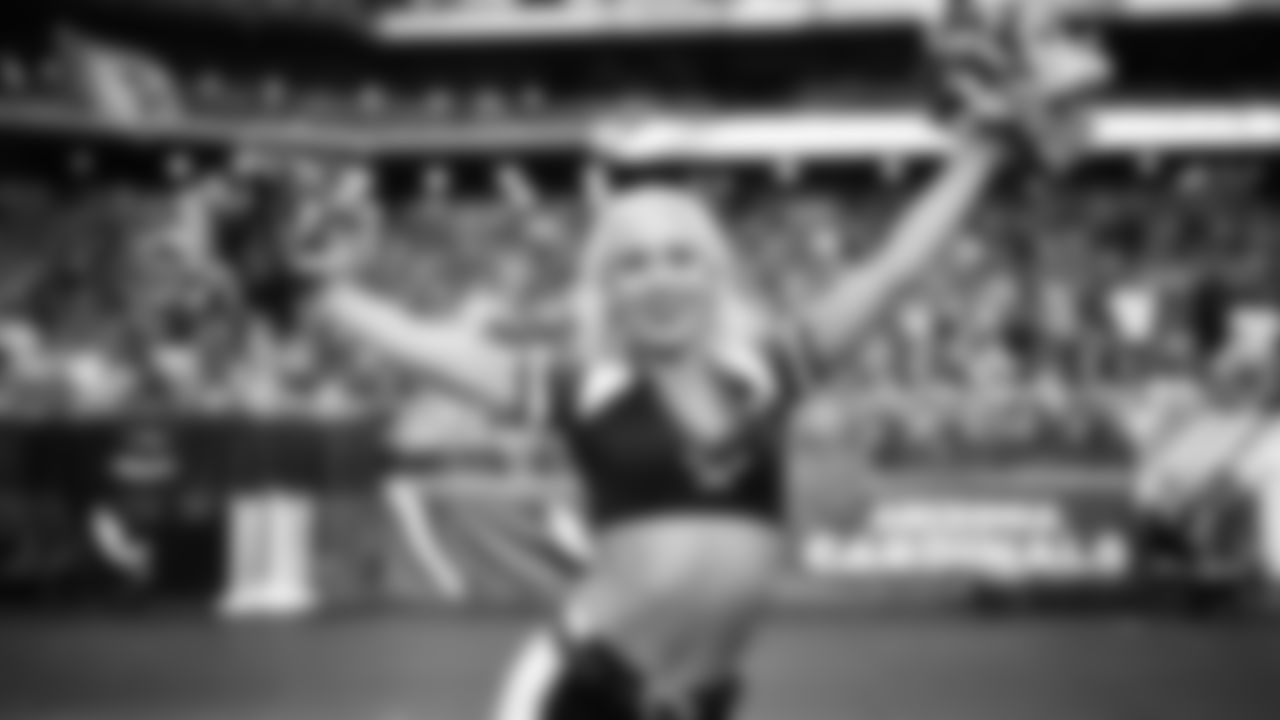 Images of Cardinals cheerleader Davis during the 2019 season