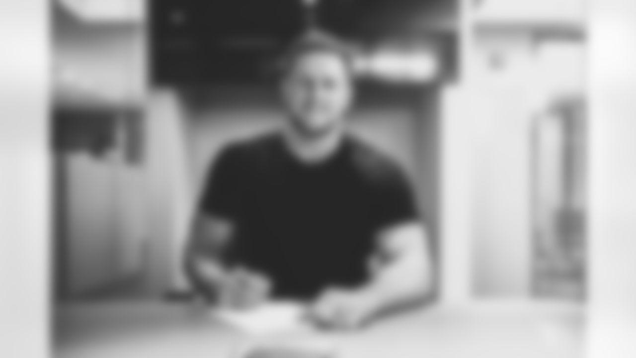 DE J.J. Watt signs his contract with the Cardinals.