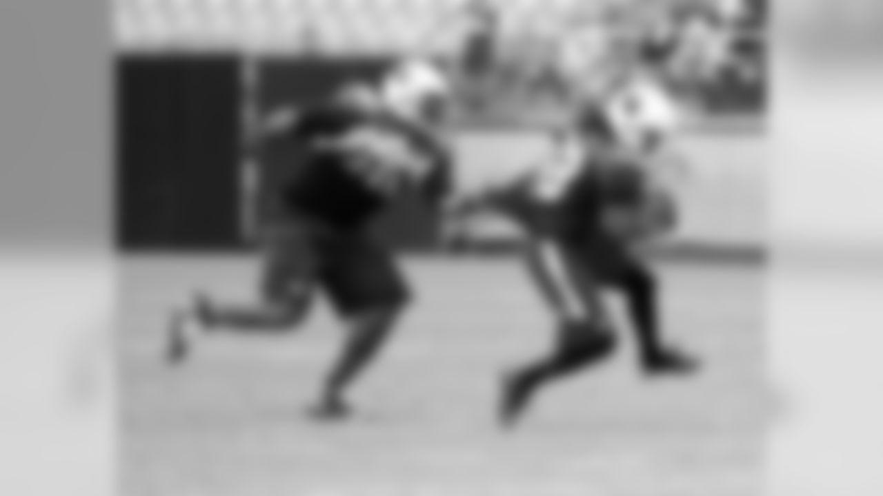 DT Darnell Dockett (left) grabs RB Andre Ellington