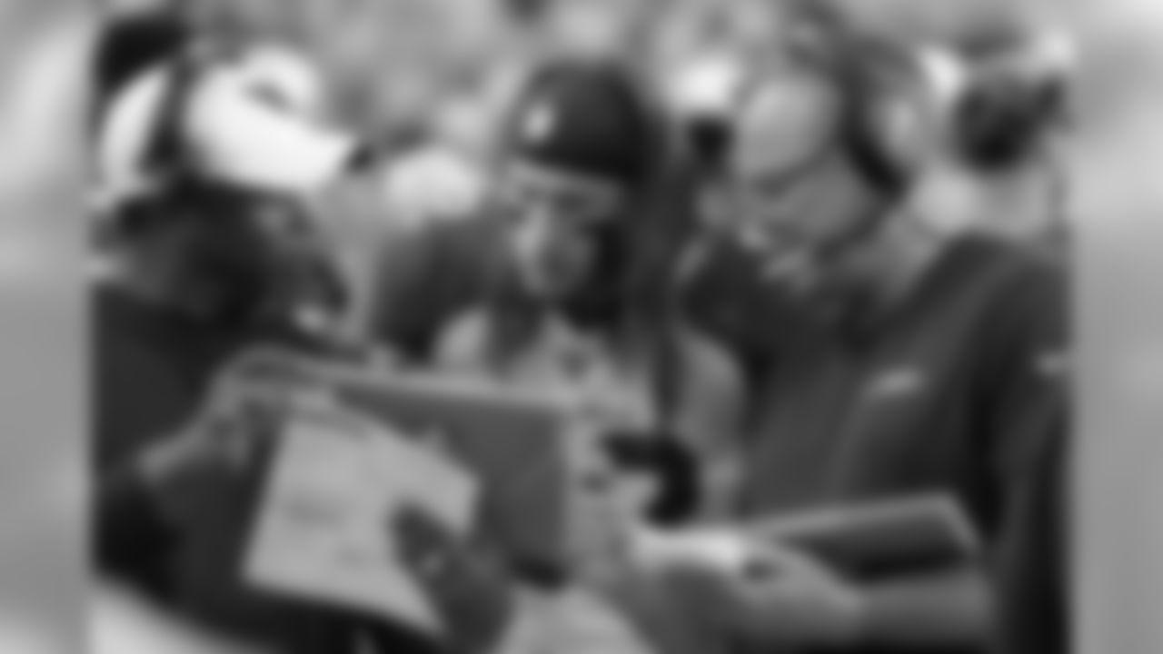LB Dennis Gardeck looks at a Microsoft Surface with DC Vance Joseph and LB coach Bill Davis.