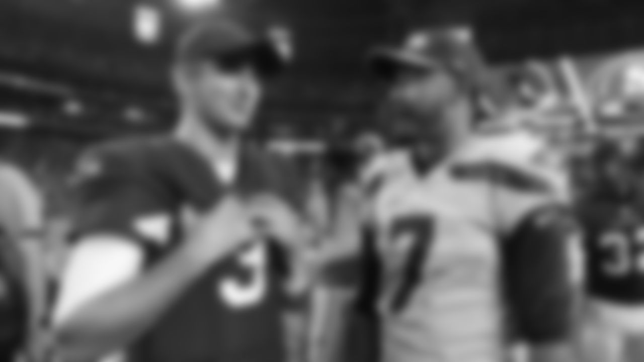 Arizona Cardinals quarterback Josh Rosen (3) talks with Seattle Seahawks quarterback Brett Hundley (7) after an NFL football game, Sunday, Sept. 30, 2018, in Glendale, Ariz. The Seahawks won 20-17. (AP Photo/Rick Scuteri)