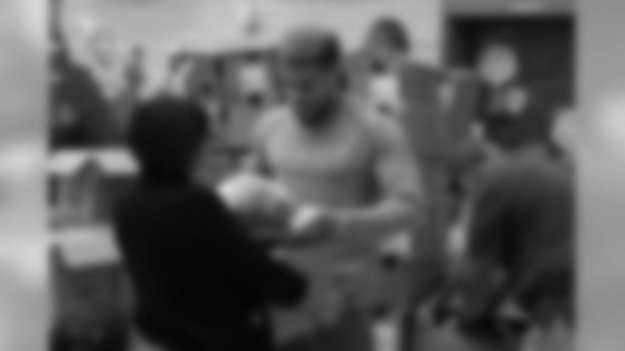 S Tyrann Mathieu handing out a turkey
