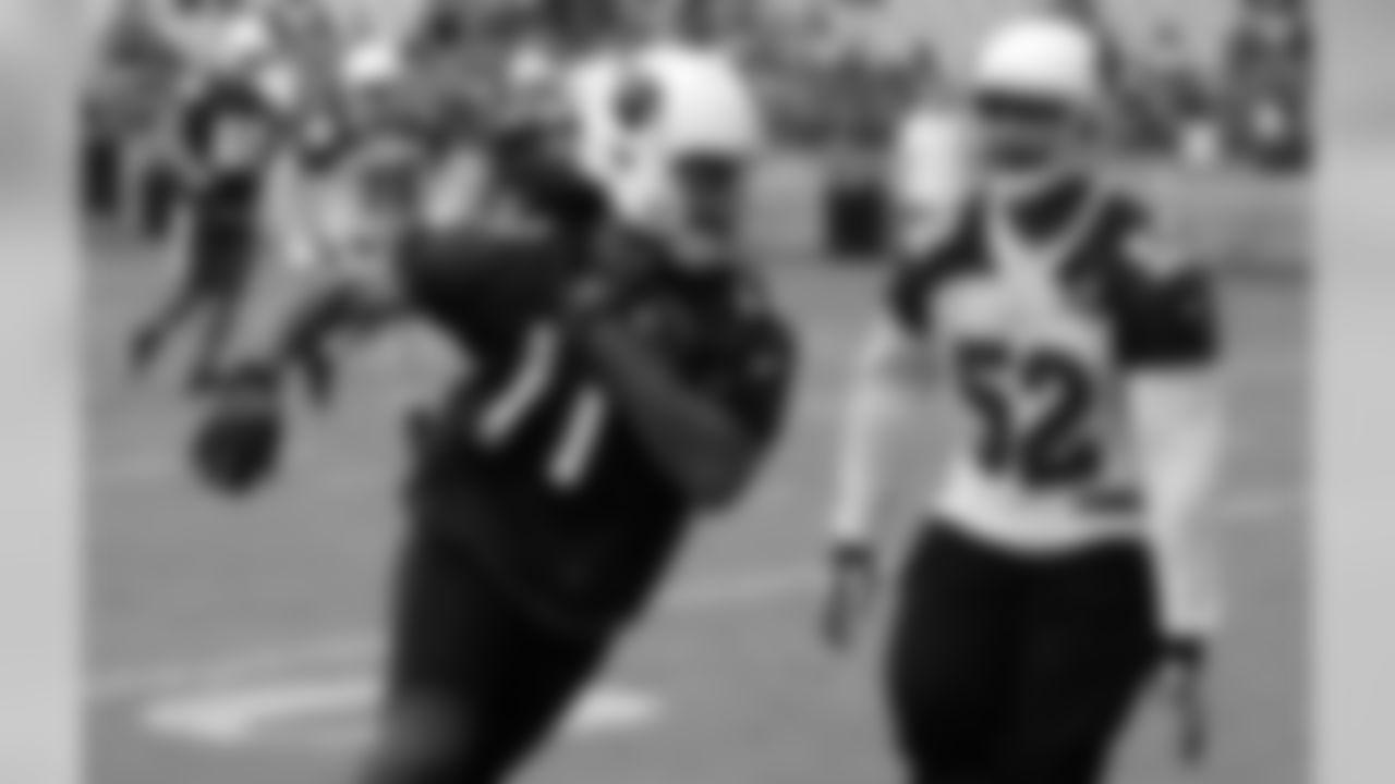 WR Larry Fitzgerald catches a pass as LB LaMarr Woodley pursues