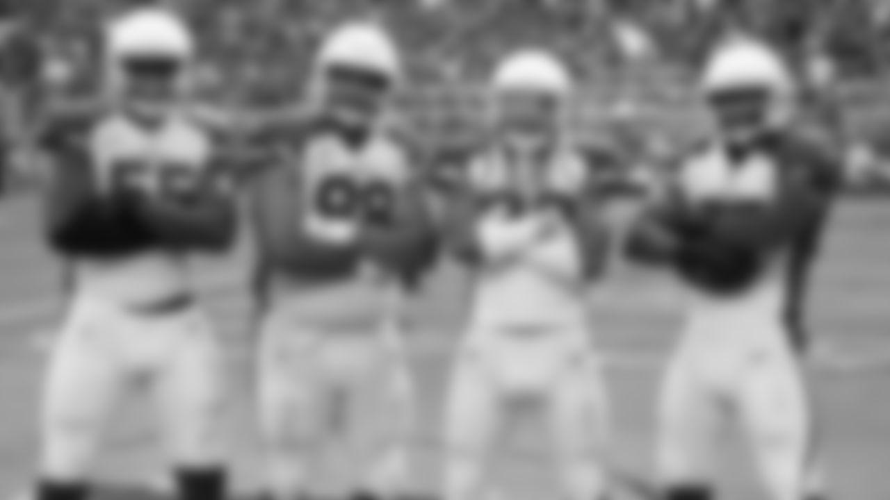 From left: DE Chandler Jones, DT Corey Peters, S Tre Boston and LB Josh Bynes celebrating a defensive touchdown