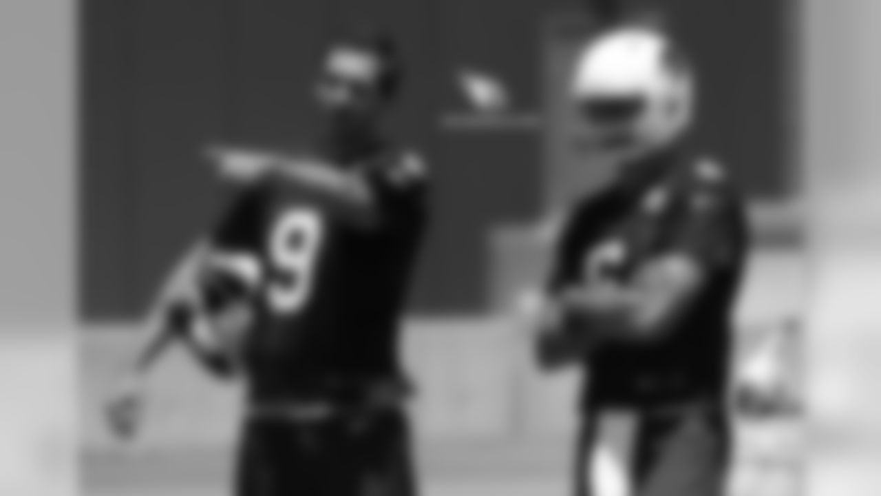 QB Sam Bradford (left) gives advice to QB Chad Kanoff