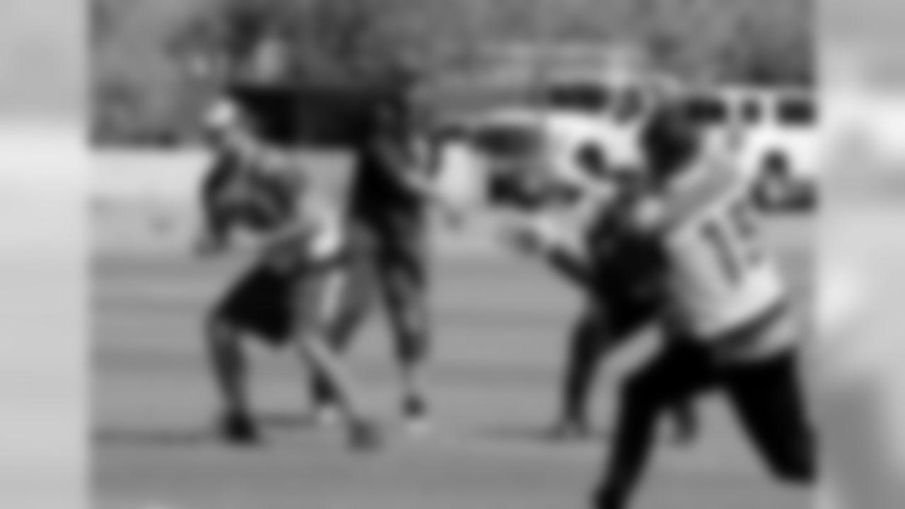 Carson Palmer fires a pass