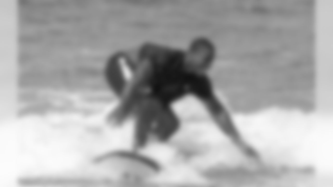 TE Gerald Christian learns to surf during part of Irrelevant Week