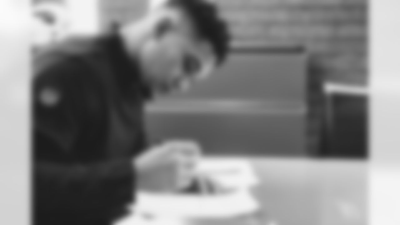 Images of veteran running back James Conner signing his one-year contract on Tuesday.