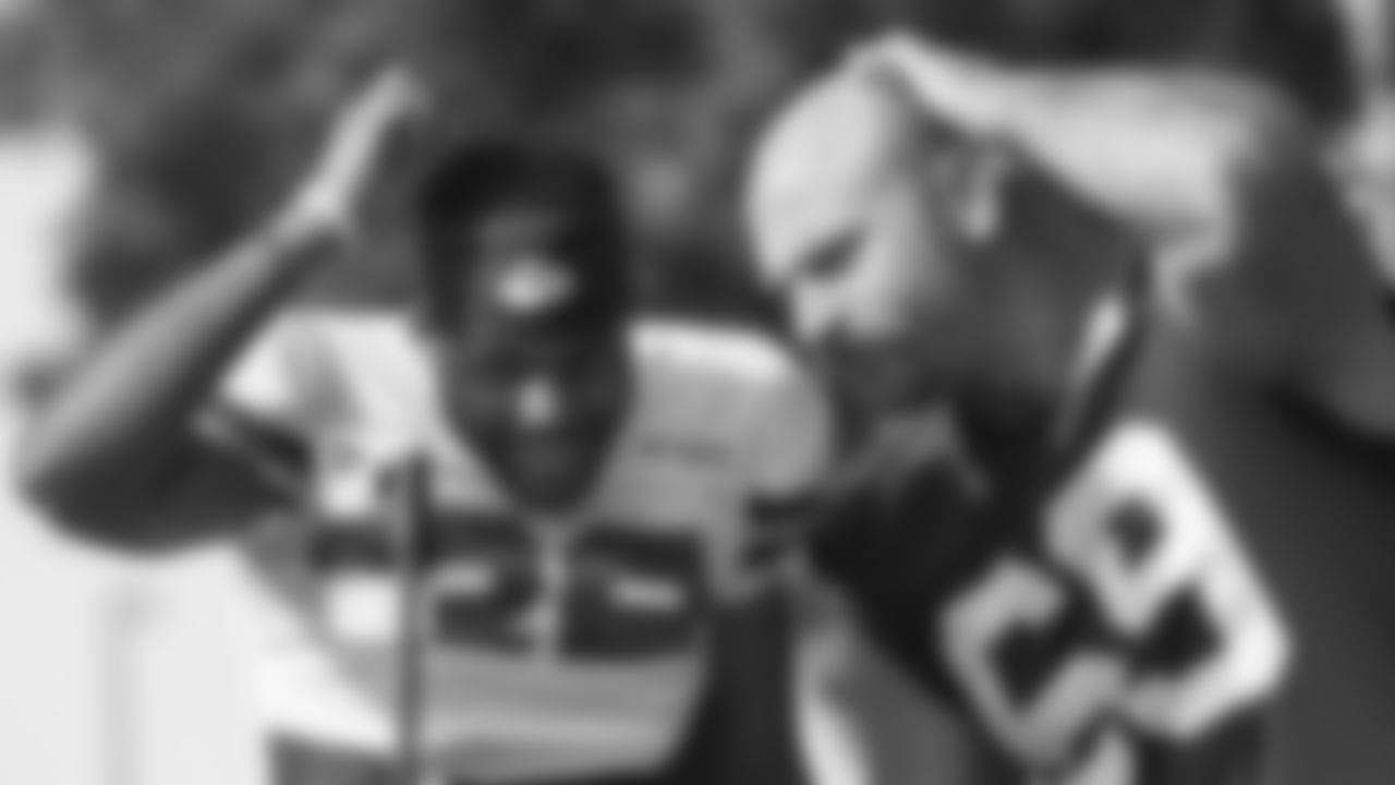 Kansas City Chiefs defensive back Juan Thornhill (22) and Kansas City Chiefs offensive guard Kyle Long (69) during training camp practice at Missouri Western State University.