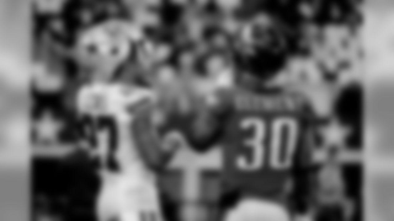 Dallas Cowboys cornerback Jourdan Lewis (27) and Philadelphia Eagles running back Corey Clement (30) before an NFL football game, in Arlington, Texas, Sunday, Dec. 9, 2018. (AP Photo/Michael Ainsworth)