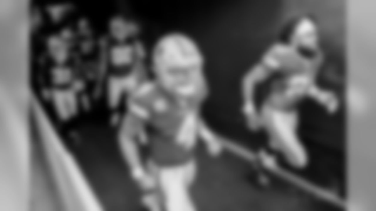 Dallas Cowboys quarterback Dak Prescott (4) and Dallas Cowboys running back Ezekiel Elliott (21) run onto the field before the first half of an NFL football game between the Washington Redskins and the Dallas Cowboys, Sunday, Oct. 21, 2018 in Landover, Md. (AP Photo/Alex Brandon)