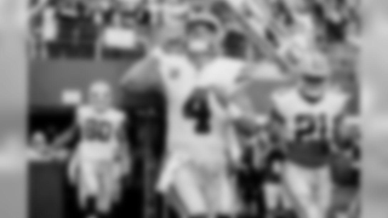 Dallas Cowboys quarterback Dak Prescott (4) runs onto the field before an NFL football game against the Detroit Lions in Arlington, Texas, Sunday, Sept. 30, 2018. (AP Photo/Roger Steinman)