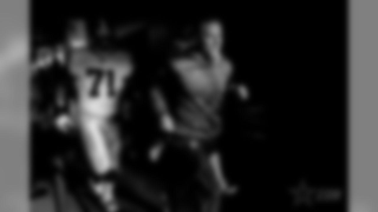 Dallas Cowboys head coach Jason Garrett, right, runs out of a tunnel with offensive tackle La'el Collins (71) prior to an NFL football game against the Philadelphia Eagles, Sunday, Nov. 11, 2018, in Philadelphia. (AP Photo/Matt Rourke)